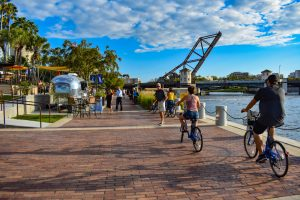 Tampa, Florida. People biking and walking at Riverwalk in downtown.