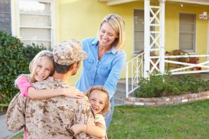 Family at their home purchased with a VA Home Loan
